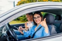 driving-school-beautiful-young-woman-successfully-passed-driving-school-test-she-looking_1391-2391